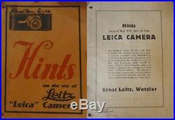 1930 LEICA IA with DEALER PLATE + 3.5cm ELMAR, CASE, 2 CASSETTES, 1929 BROCHURE