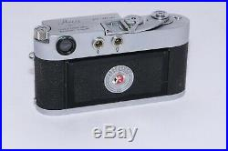 Leica M2 35mm film rangefinder camera body with case. Good shooter body