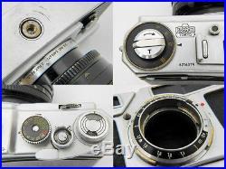 Vintage Nikon SP camera, lens Nikkor-N 11,1/f=5omm, Nikon UV filter, leather case